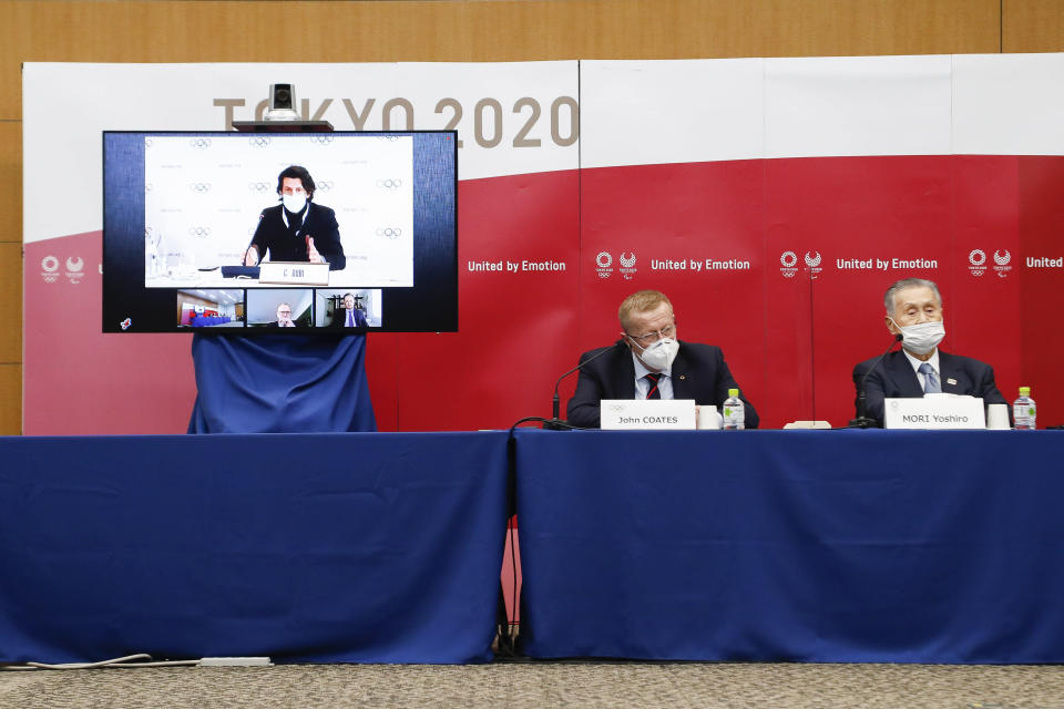 Left to right; Christophe Dubi Executive Director of Olympic Games (on the screen), John Coates Chairman of the Coordination Commission for the Games of the XXXII Olympiad Tokyo 2020 and Yoshiro Mori President of Tokyo 2020, speak during a joint press conference in Tokyo, Wednesday, Nov. 18, 2020. (Rodrigo Reyes Marin/Pool Photo via AP)
