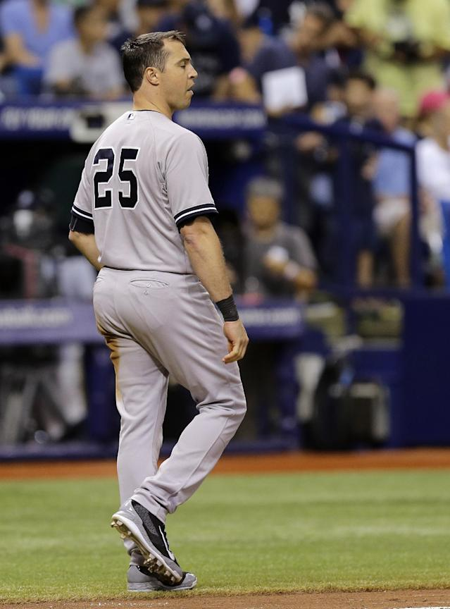 New York Yankees' Mark Teixeira walks off after striking out with the bases loaded against Tampa Bay Rays relief pitcher Brad Boxberger during the eighth inning of a baseball game Friday, Aug. 15, 2014, in St. Petersburg, Fla. (AP Photo/Chris O'Meara)