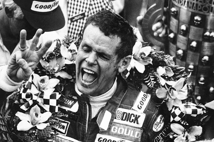 FILE - In this May 24, 1981, file photo, Bobby Unser holds three fingers aloft after winning his third Indianapolis 500 auto race ,in Indianapolis, Ind. Three-time Indianapolis 500 winner Bobby Unser has died. He died of natural causes at his home in Albuquerque, New Mexico, on Sunday, May 2, 2021. He was 87. (AP Photo/File)