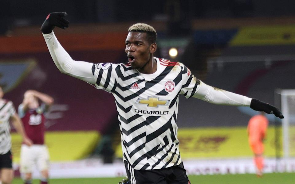 Manchester United's Paul Pogba celebrates after scoring during the English Premier League soccer match between Burnley and Manchester United in Burnley, - AP