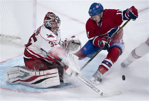 Carolina Hurricanes goalie Justin Peters makes the save off Montreal Canadiens' Brendan Gallagher during third period NHL hockey action Monday, April 1, 2013 in Montreal. The Canadiens beat the Hurricanes 4-1. (AP Photo/The Canadian Press, Paul Chiasson)