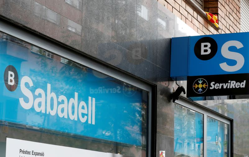 FILE PHOTO: FILE PHOTO: A Catalan flag is seen above a logo at the Sabadell bank branch in Barcelona