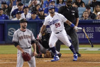 Los Angeles Dodgers' Albert Pujols, second from right, hits a solo home run as Arizona Diamondbacks relief pitcher Alex Young, left, and catcher Bryan Holaday, second from left, watch along with home plate umpire Tony Randazzo during the seventh inning of a baseball game Saturday, July 10, 2021, in Los Angeles. (AP Photo/Mark J. Terrill)