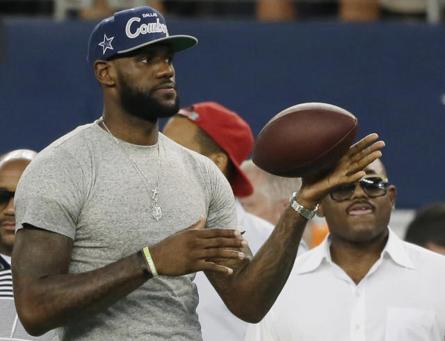 """LeBron James tosses a ball around before an NFL game between the Dallas Cowboys and the <a class=""""link rapid-noclick-resp"""" href=""""/nfl/teams/ny-giants/"""" data-ylk=""""slk:New York Giants"""">New York Giants</a> on Sept. 8, 2013, in Arlington, Texas. (AP Photo/Tony Gutierrez)"""