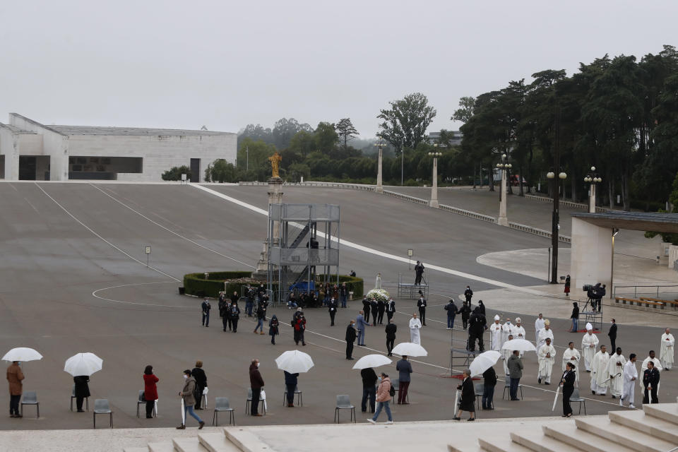 The statue of Our Lady of Fatima is carried during celebrations at a virtually empty Catholic shrine in Fatima, Portugal, Wednesday, May 13, 2020. The dean of the shrine has asked pilgrims to stay away from the shrine, which is cordoned off during the annual celebrations, in an attempt to stem the spread of the coronavirus. Hundreds of thousands of worshippers traditionally attend ceremonies on May 12 and 13. (AP Photo/Armando Franca)