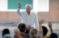 Mexico's President Andres Manuel Lopez Obrador waves during a meeting with relatives of the 65 miners who died during an explosion at Pasta de Conchos coal mine, in San Juan de Sabinas