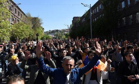 Demonstrators attend a protest against Armenia's ruling Republican party's nomination of former President Sarksyan as its candidate for prime minister, in Yerevan