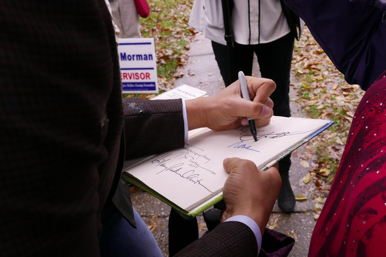 Cory Booker signs an autograph at an event in Adel, Iowa, on Oct. 8. (Photo: Hunter Walker/Yahoo News)