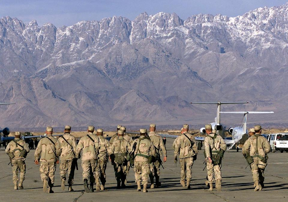 American soldiers approach UN planes on the tarmac of Bagram airbase on 15 January 2002 in this file photo (AFP via Getty Images)