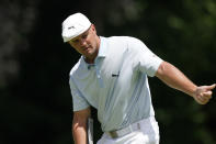 Bryson DeChambeau gestures as he putts on the ninth green during the second round of the Rocket Mortgage Classic golf tournament, Friday, July 2, 2021, at the Detroit Golf Club in Detroit. (AP Photo/Carlos Osorio)