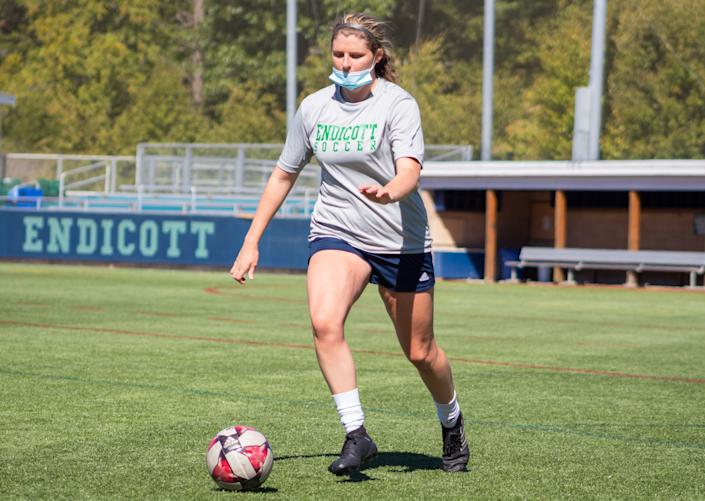 A masked of Jaymie Caponigro takes part in an Endicott College women's soccer practice during a season in which all intercollegiate games were canceled due to the coronavirus crisis.(Endicott College Sports Information)