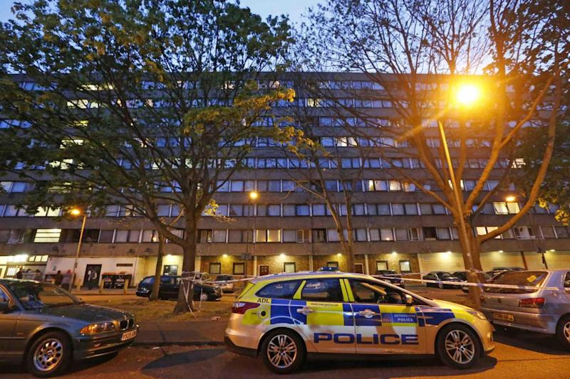 Cordon: Police in Battersea after the teenager was stabbed to death (NIGEL HOWARD)