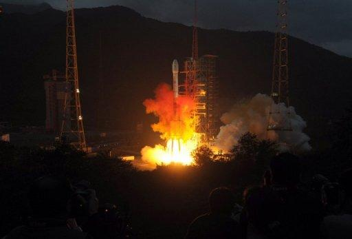 This file photo shows a Long March 3C rocket blasting off from the launch centre in Xichang, China's southwestern province of Sichuan, in 2010. China will next year attempt to land an exploratory craft on the moon for the first time, state media reported, in the latest project in the country's ambitious space programme
