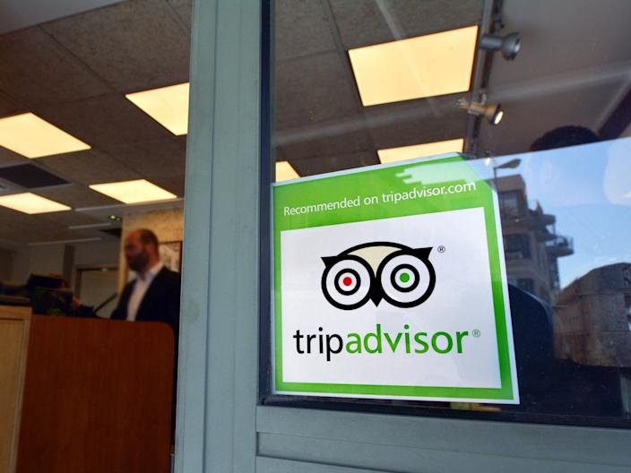"A TripAdvisor sign on a storefront, a ubiquitous site at tourist spots around the world. <p class=""copyright"">Shutterstock</p>"