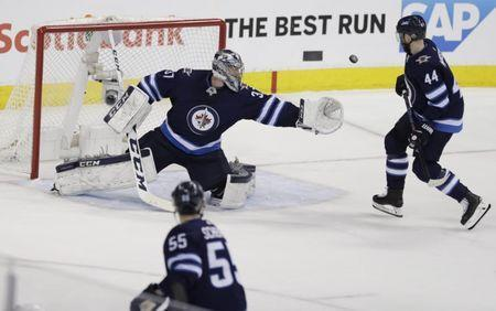 May 20, 2018; Winnipeg, Manitoba, CAN; Winnipeg Jets goaltender Connor Hellebuyck (37) catches the puck against the Vegas Golden Knights in the second period in game five of the Western Conference Final of the 2018 Stanley Cup Playoffs at Bell MTS Centre. Mandatory Credit: James Carey Lauder-USA TODAY Sports
