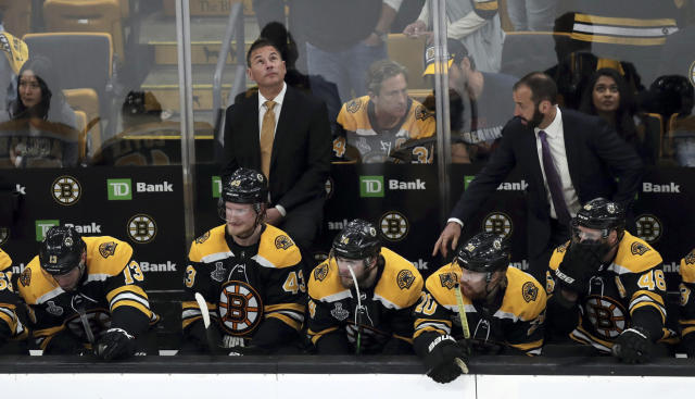 Boston Bruins head coach Bruce Cassidy checks the clock as time winds down during the third period in Game 7 of the NHL hockey Stanley Cup Final against the St. Louis Blues, Wednesday, June 12, 2019, in Boston. (AP Photo/Charles Krupa)
