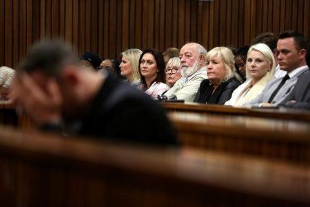 Reeva Steenkamp's parents, June and Barry Steenkamp, look on as Oscar Pistorius reacts during the third day of his resentencing hearing for the 2013 murder of his girlfriend Reeva, in the North Gauteng High Court in Pretoria, South Africa June 15, 2016. REUTERS/Alon Skuy/Pool/Files