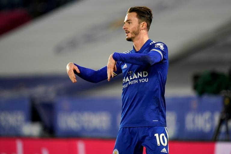 Leicester City's James Maddison celebrates in a socially distanced fashion