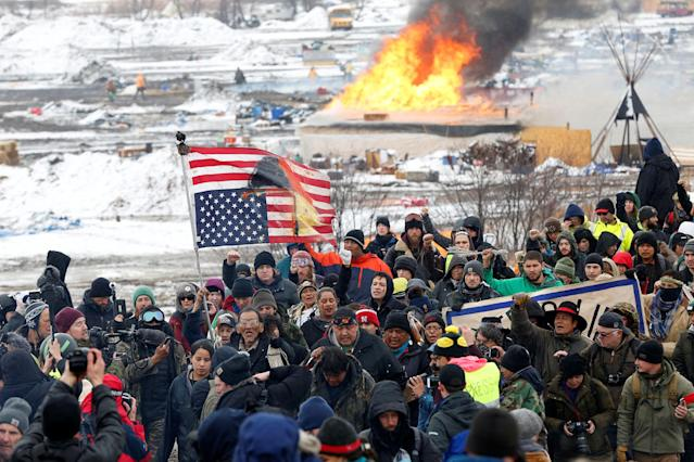 <p>FEB. 22, 2017 – Opponents of the Dakota Access oil pipeline march out of their main camp near Cannon Ball, North Dakota. (Photo: Terray Sylvester/Reuters) </p>