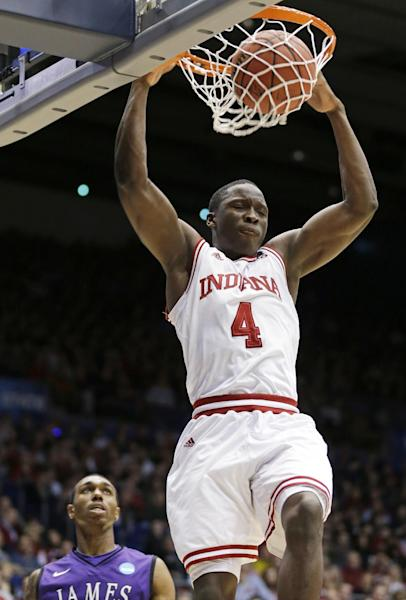 Indiana guard Victor Oladipo (4) dunks past James Madison guard Devon Moore in the first half of a second-round game at the NCAA college basketball tournament on Friday, March 22, 2013, in Dayton, Ohio. (AP Photo/Al Behrman)