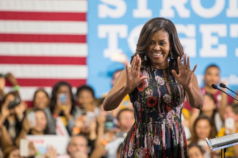 """US First Lady Michelle Obama has joined the campaign trail to deliver a fiery takedown of Donald Trump and his """"disgraceful"""" behavior (AFP Photo/Zach Gibson)"""