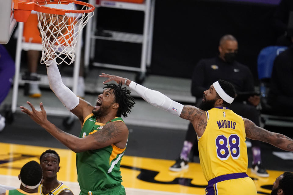 Utah Jazz center Derrick Favors, left, drives past Los Angeles Lakers forward Markieff Morris, right, during the first half of an NBA basketball game Monday, April 19, 2021, in Los Angeles. (AP Photo/Marcio Jose Sanchez)