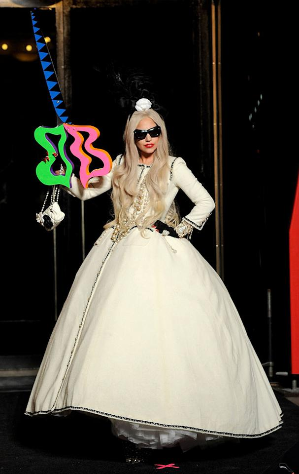 "The pop star proudly posed with a crazy pair of neon scissors at the event, where clowns-turned-carolers sang some of Gaga's most popular tunes, including ""The Edge of Glory"" and ""Born This Way."" ""It's a 'Charlie and the Chocolate Factory' moment,"" Gaga said of the shop, which sells everything from Swarovski-encrusted tea cups to stiletto Christmas stockings. ""We wanted it all to be whimsical and fun, with a sense of art and fashion."" (11/21/2011)"