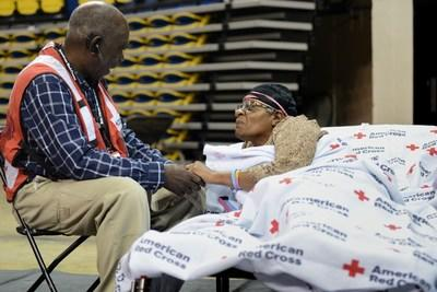 Red Cross Shelter worker, Waymond Hackney, provides comfort to shelter resident, Beverly Coates during Hurricane Barry. Contributions from Annual Disaster Giving Program (ADGP) and Disaster Responder Program members ensure the American Red Cross is prepared to provide help and hope to people affected by disasters like storms and countless other crises. Daniel Cima/American Red Cross.