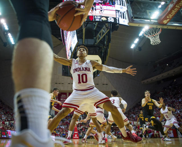 Indiana guard Rob Phinisee (10) defends against an Iowa player as they attempt to in-bound the ball during the second half of an NCAA college basketball game, Thursday, Feb. 13, 2020, in Bloomington, Ind. (AP Photo/Doug McSchooler)