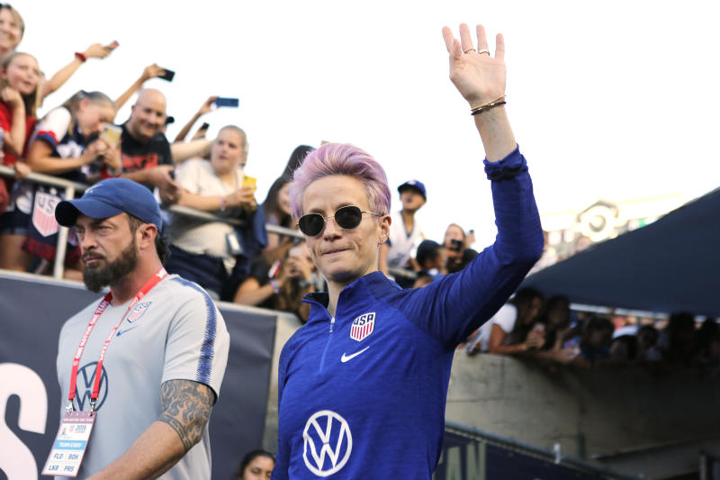 PASADENA, CALIFORNIA - AUGUST 03: Megan Rapinoe #15 of United States waves to fans as she takes the field ahead of the first game of the USWNT Victory Tour against Republic of Ireland at Rose Bowl on August 03, 2019 in Pasadena, California. (Photo by Katharine Lotze/Getty Images)