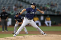 Seattle Mariners' Marco Gonzales throws against the Oakland Athletics during the first inning of a baseball game in Oakland, Calif., Tuesday, Sept. 21, 2021. (AP Photo/Jed Jacobsohn)