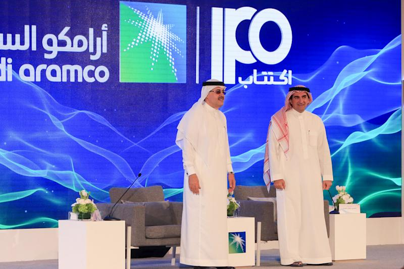 """President and CEO of Saudi Aramco Amin Nasser (L) and Aramco's chairman Yasir al-Rumayyan attend a press conference in the eastern Saudi Arabian region of Dhahran on November 3, 2019. - Saudi Aramco confirmed it planned to list on the Riyadh stock exchange, describing it as a """"significant milestone"""" in the history of the energy giant. (Photo by - / AFP) (Photo by -/AFP via Getty Images)"""