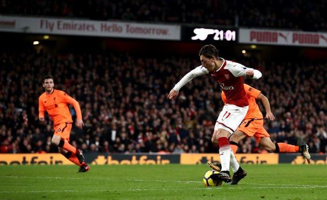Ozil's unique finish saw him score past Liverpool goalkeeper Simon Mignolet during a thrilling draw in 2017.