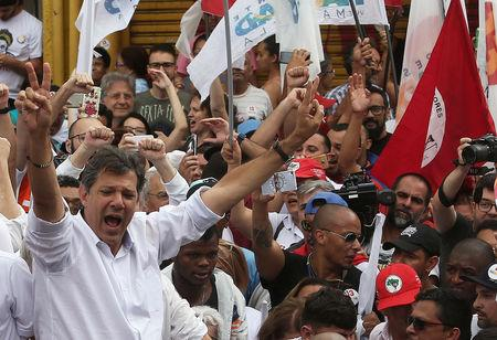 Fernando Haddad, presidential candidate of Brazil's leftist Workers Party (PT), flashes the victory sign during a march for peace at Heliopolis slum in Sao Paulo, Brazil October 27, 2018. REUTERS/Amanda Perobelli