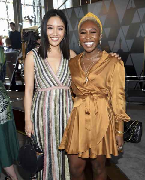 Actors Constance Wu, left, and Cynthia Erivo attend the Academy of Motion Picture Arts and Sciences Women's Initiative New York luncheon at the Rainbow Room on Wednesday, Oct. 2, 2019, in New York. (Photo by Evan Agostini/Invision/AP)