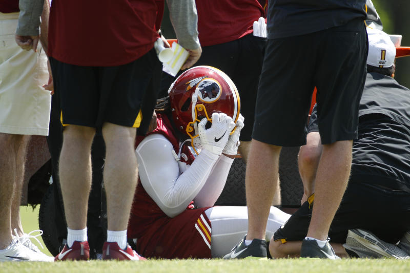 Washington Redskins linebacker Reuben Foster reacts as he is tended to after suffering an injury during a practice at the team's NFL football practice facility, Monday, May 20, 2019, in Ashburn, Va. (AP Photo/Patrick Semansky)