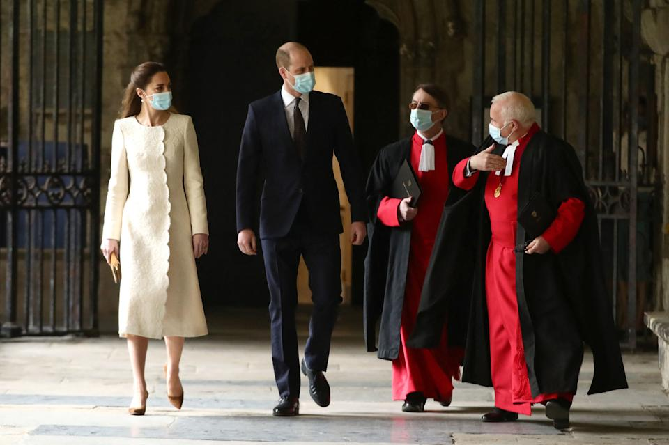 Britain's Prince William, Duke of Cambridge and Britain's Catherine, Duchess of Cambridge, accompanied by the Dean of Westminster The Very Reverend David Hoyle (R) and the Receiver General and Chapter Clerk, Paul Baumann, (2R), arrive for a visit to the coronavirus vaccination centre at Westminster Abbey, central London on March 23, 2021, to pay tribute to the efforts of those involved in the Covid-19 vaccine rollout. (Photo by Aaron Chown / POOL / AFP) (Photo by AARON CHOWN/POOL/AFP via Getty Images)