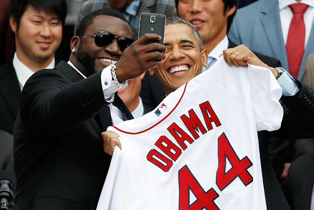 "WASHINGTON, DC - APRIL 01: Boston Red Sox designated hitter David Ortiz (L) poses for a ""selfie"" with U.S. President Barack Obama during a ceremony on the South Lawn of the White House to honor the 2013 World Series Champion Boston Red Sox April 1, 2014 in Washington, DC. The Red Sox defeated the St. Louis Cardinals in the 2013 World Series. (Photo by Win McNamee/Getty Images)"