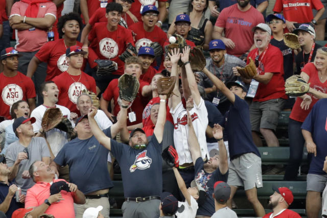 Fans battle for a home run ball hit by Vladimir Guerrero Jr., of the Toronto Blue Jays, during the Major League Baseball Home Run Derby, Monday, July 8, 2019, in Cleveland. The MLB baseball All-Star Game will be played Tuesday. (AP Photo/Tony Dejak)