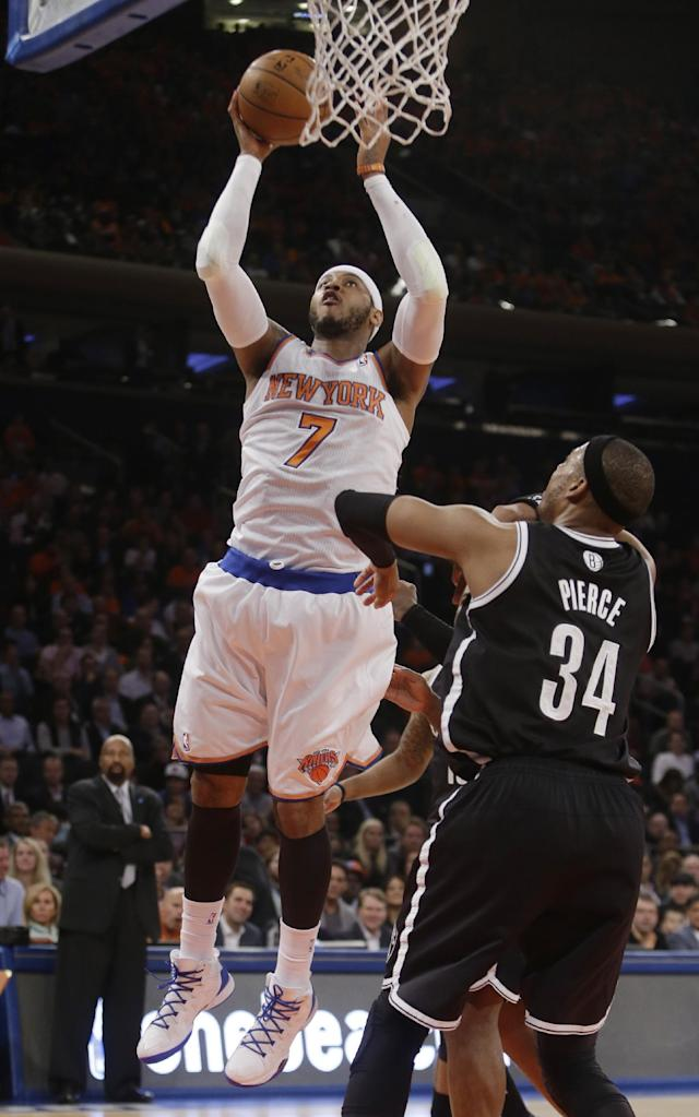 New York Knicks' Carmelo Anthony (7) shoots over Brooklyn Nets' Paul Pierce (34) during the first half of an NBA basketball game Wednesday, April 2, 2014, in New York. (AP Photo/Frank Franklin II)