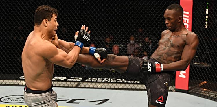 Israel Adesanya lands front kick on Paulo Costa at UFC 253