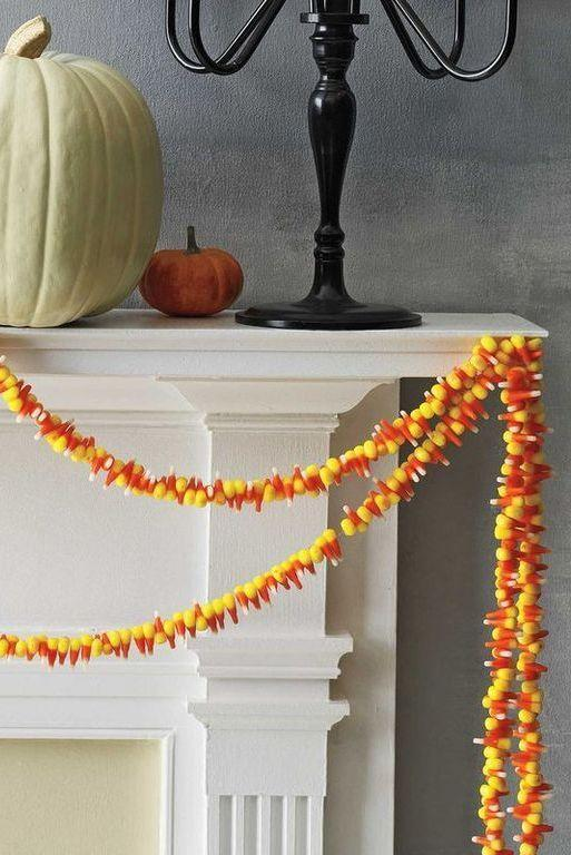 """<p>To make this easy candy corn garland, thread monofilament fishing line onto a needle and poke it through the candies, avoiding areas where the colors meet, as corn can break at those points. Then, simply hang on a mantel or a staircase using cloth tape.</p><p><a class=""""link rapid-noclick-resp"""" href=""""https://www.amazon.com/KastKing-FluoroKote-Fluorocarbon-Coated-Fishing/dp/B017AR85Y8?tag=syn-yahoo-20&ascsubtag=%5Bartid%7C10070.g.1908%5Bsrc%7Cyahoo-us"""" rel=""""nofollow noopener"""" target=""""_blank"""" data-ylk=""""slk:SHOP MONOFILAMENT FISHING LINE"""">SHOP MONOFILAMENT FISHING LINE</a></p>"""