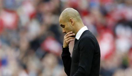 Britain Football Soccer - Arsenal v Manchester City - FA Cup Semi Final - Wembley Stadium - 23/4/17 Manchester City manager Pep Guardiola looks dejected after the match Action Images via Reuters / Carl Recine Livepic