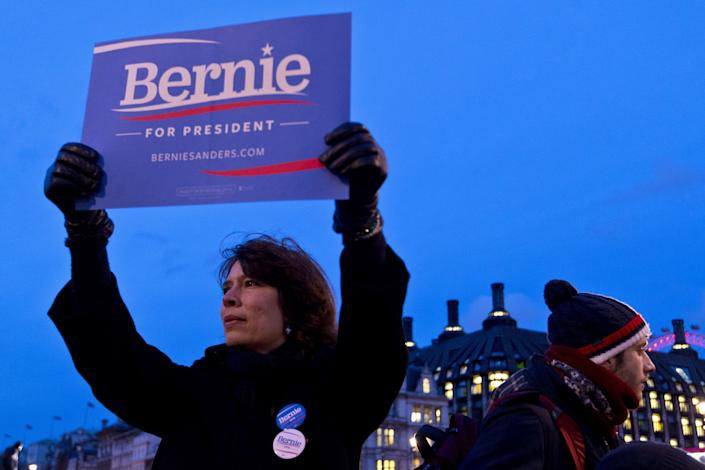 LONDON, ENGLAND - MARCH 01: A supporter of American Democrat candidate Bernie Sanders waves a sign with the slogan 'Bernie For President' during a Super Tuesday rally in Parliament Square on March 1, 2016 in London, England. Super Tuesday is a day in the United States presidential primary season where a large number of states hold their primary elections. American citizens abroad are allowed to vote for their chosen candidate at local polling centres. (Photo by Ben Pruchnie/Getty Images)