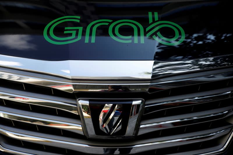 FILE PHOTO: A Grab vehicle is pictured in Singapore