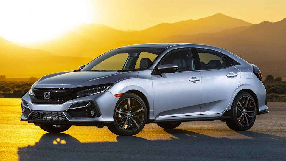 """<p><strong>Score: 6.9 / 10</strong></p> <p>The current <a href=""""https://www.motor1.com/reviews/426761/2020-honda-civic-hatchback-sport-touring-review/"""" rel=""""nofollow noopener"""" target=""""_blank"""" data-ylk=""""slk:Honda Civic"""" class=""""link rapid-noclick-resp"""">Honda Civic</a> has been on sale for a number of years, but even into 2020, the hatchback still proves a likable thing. The Civic gets its highest marks in safety and comfort but does well in virtually every category. The Sport Touring model specifically gets a 6.9 out of 10.</p> <br><a href=""""https://www.motor1.com/reviews/426761/2020-honda-civic-hatchback-sport-touring-review/"""" rel=""""nofollow noopener"""" target=""""_blank"""" data-ylk=""""slk:2020 Honda Civic Hatchback Sport Touring Review: Happy Hatch"""" class=""""link rapid-noclick-resp"""">2020 Honda Civic Hatchback Sport Touring Review: Happy Hatch</a><br>"""
