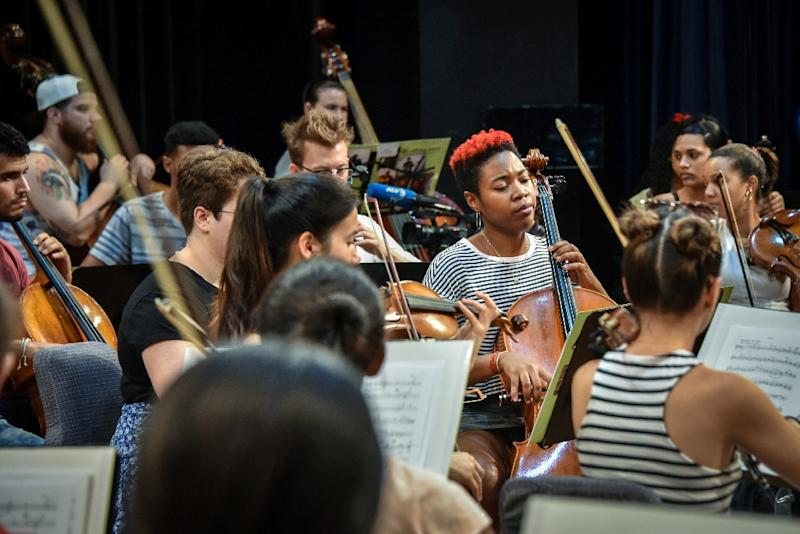 On Havana's National Theatre stage, where the Cuban American Youth Orchestra has been rehearsing all week, it's difficult to distinguish the different nationalities of the violinists, clarinetists and cellists as they play in perfect unison (AFP Photo/ADALBERTO ROQUE)