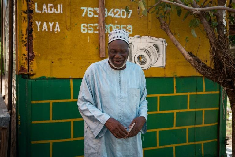 He captured sacred fishing rituals, portraits of young Malians decked in traditional robes and even photographed Libya's former leader, Colonel Muammar Gaddafi, during a state visit