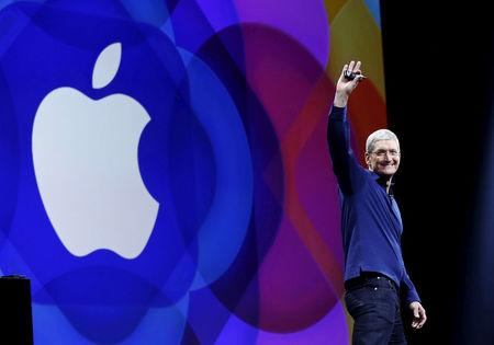 FILE PHOTO: Apple CEO Tim Cook waves as he arrives on stage to deliver his keynote address at the Worldwide Developers Conference in San Francisco, California
