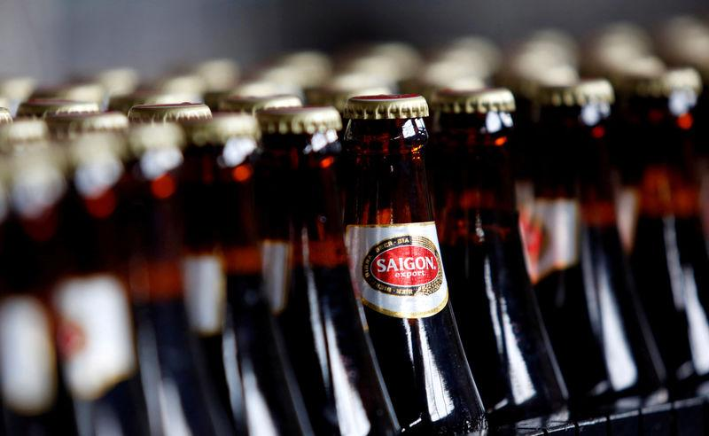 FILE PHOTO: Bottles of beer move along a production line at a factory of Saigon Beer Corporation (Sabeco) in Hanoi